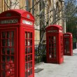 Telephone booths on a London street — Stock Photo #7781171