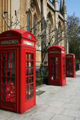 Telephone booths on a London street — Stock Photo