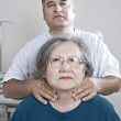 Doctor examing thyroid — Stock Photo