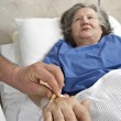 Adult helping senior in hospital — Stock Photo #7567143