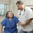 Hospital room doctor and patient — Stock Photo #7567189
