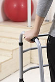Female patient with walker — Stock Photo