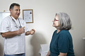 Male doctor talking with his patient — Stock Photo