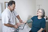 Doctor exam mature patient — Stock Photo