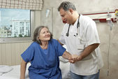 Hospital room doctor and patient — Stock Photo