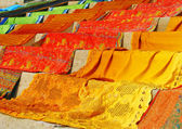 Vivid saris drying in the sun — Stock Photo