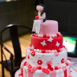 Red, pink and white wedding cake — Stock Photo #7536442