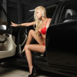Sexy blond girl sitting in a luxury car — Stock Photo