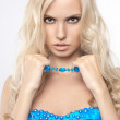 Blong girl in blue clothing — Stock Photo