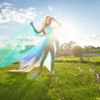 Young woman dancing in the morning bright spring orchard — Stock Photo