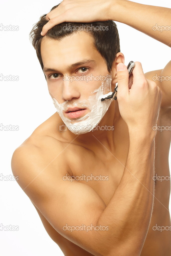 Sexy handsome young man with a shaving foam — Stock Photo #7659462