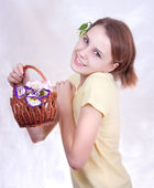 Girl with flower basket — Stock Photo