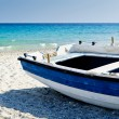 Stock Photo: Old dinghy aground