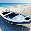 Stock Photo: Colourful dinghy, beach resort