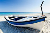 Colourful dinghy, beach resort — Stock Photo