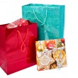Stock Photo: Glossy festive gift bags and gift box