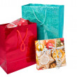 Glossy festive gift bags and gift box — Stock Photo