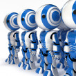 Row of Industrial Robots to Replace Human Workers — Stock Photo