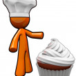 Orange Man Cook with Chef Hat Presenting Cupcake - Stock Photo