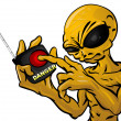 Alien Holding Remote Threatening - Stock Photo