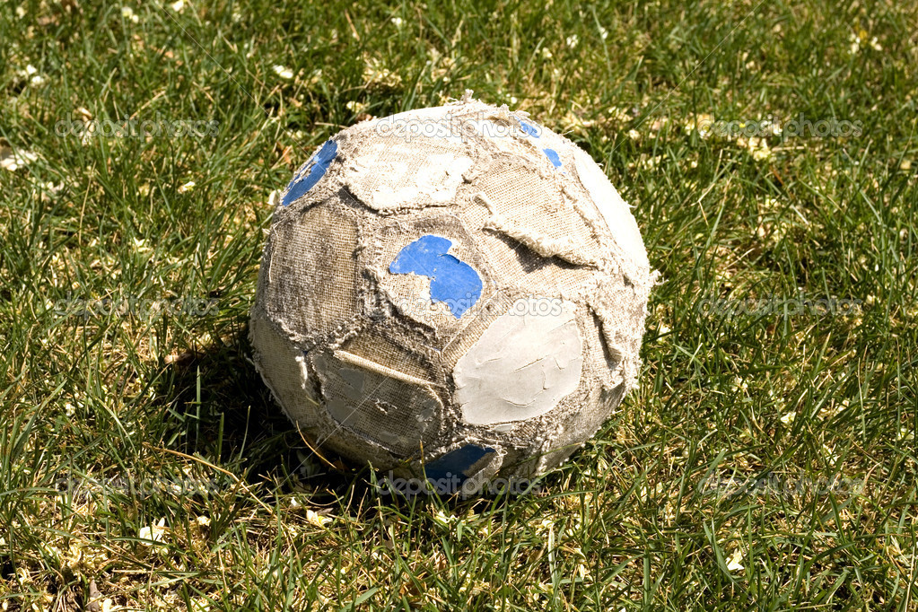 Old soccer ball on the field — Stock Photo #7652636