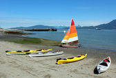 Kayaks and a Sailboat — Stock Photo