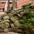 Stacking sandbags — Stock Photo