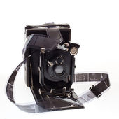 Old camera with negatives — Stock Photo