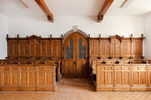 Wooden church banks — Stock Photo