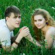 Stock Photo: Girl and boy on grass