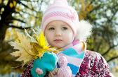 Kid in autumn — Stock Photo
