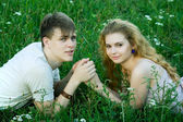 Girl and boy on the grass — Stock Photo