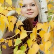 Stock Photo: Young woman near the tree