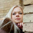 Stock Photo: Blonde near the brick wall