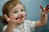 Kid and chocolate — Stock Photo