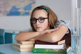 Girl with glasses with books — Stock Photo