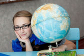 Girl with a globe — Stock Photo