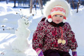 Kid and snowman — Stock Photo