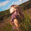 Girl sitting on the green grass — Stock Photo