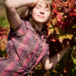 Girl near the ashberry bush shrub — Stock Photo