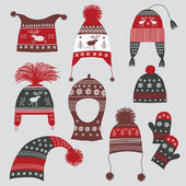 Winter hats with nordic ornament — Stock Vector