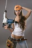 сексуальный молодой женщина - рабочий-строитель — Стоковое фото