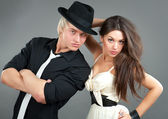 Love young couple in hats — Stok fotoğraf