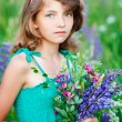 Royalty-Free Stock Photo: Little girl in the field with flowers