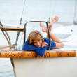 Royalty-Free Stock Photo: Playful pretty little girl on sail boat