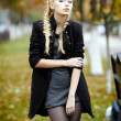 Young beautiful girl in autumn background — Stock Photo #7562890