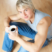 Young man drinking coffee — Stok fotoğraf