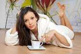 Young woman in a white robe — Stock Photo