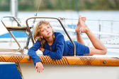 Playful pretty little girl on sail boat — Stock Photo