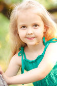 Portrait of a little girl in the summer sarafan — Stock Photo